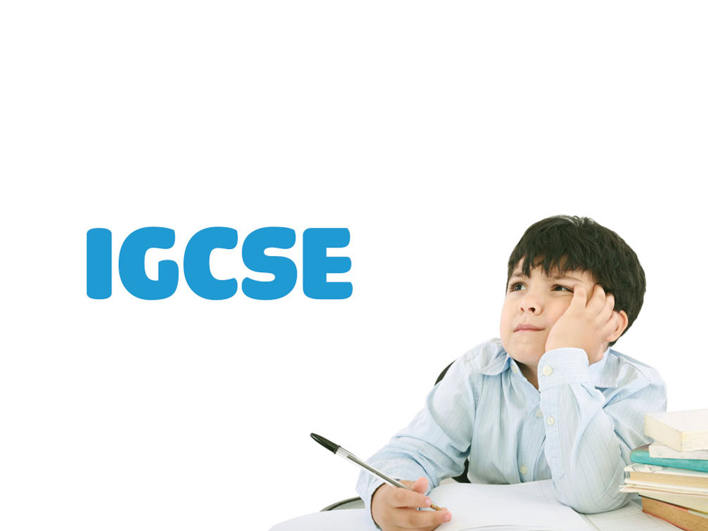 Why is IGCSE easy to pass but difficult to get high scores
